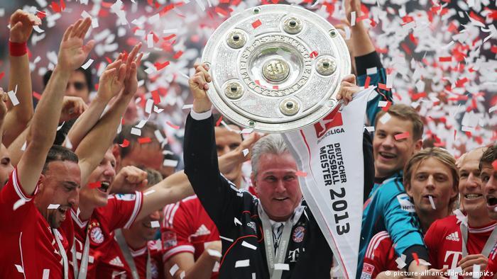 Jupp Heynckes holds up Bundesliga trophy