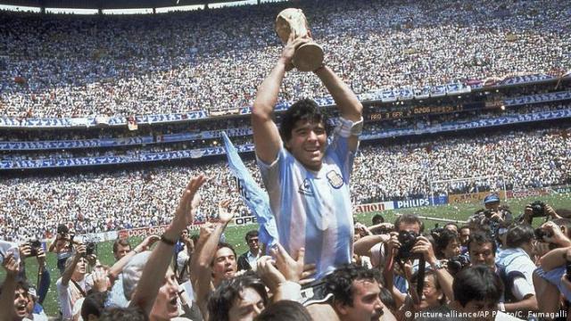 Diego Maradona with the World Cup