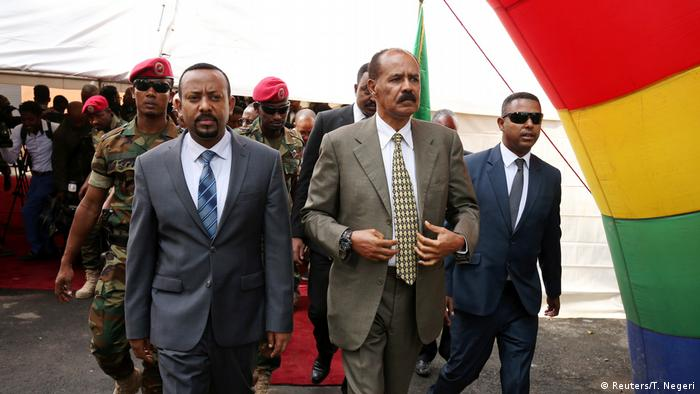 Abiy and Isaias walk together in Addis Ababa