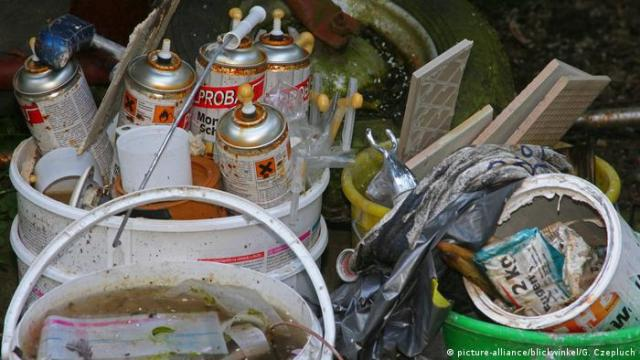 Illegally dumped spray cans and paint in Germany