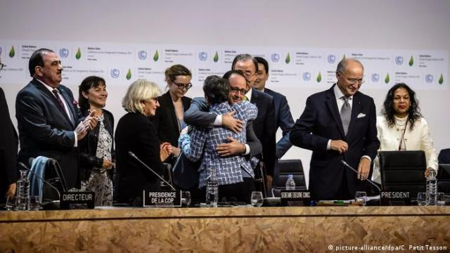 Negotiator at the climate negotiations embrace as the Paris Agreement enters history