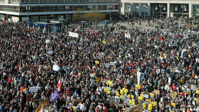 Bird's-eye view of protesters filling a square in Berlin