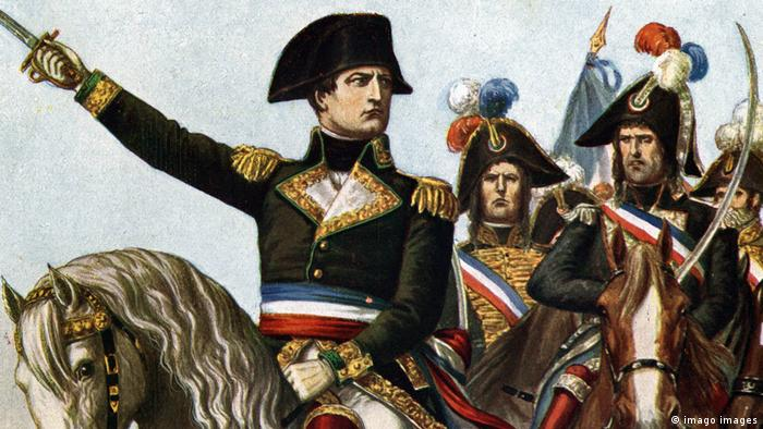 Military general Napoleon and his officers sit upon horses waving swords.