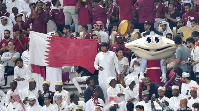 A shot of fans raising the flag of Qatar during the match between Qatar and Yemen in the Gulf Cup in Doha, 11/30/2019