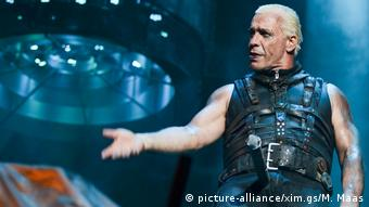 Till Lindemann, singer of the band Rammstein, performing in leather bondage gear at the Wacken Open Air festival in 2013