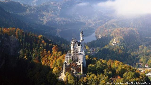 Arieal view of Neuschwanstein Castle and surrounding woods in Bavaria, Germany
