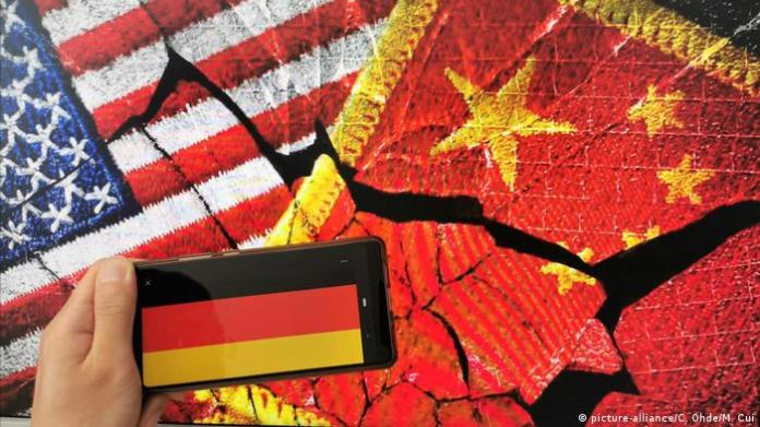 A symbolic image of the US, Chinese, and German flags