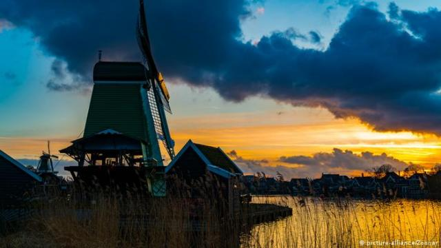 View of windmills at Zaanse Schans in Netherlands at sunset