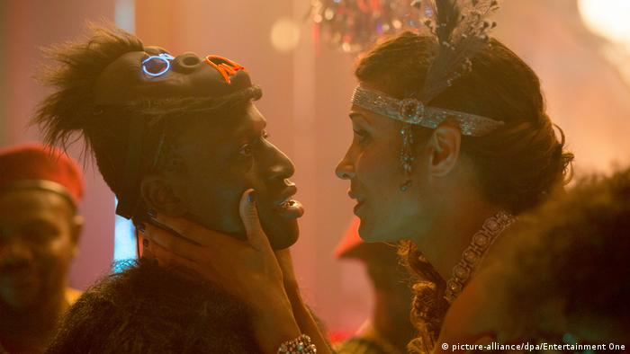 A scene from the remake of Berlin Alexanderplatz shows two people about to kiss.