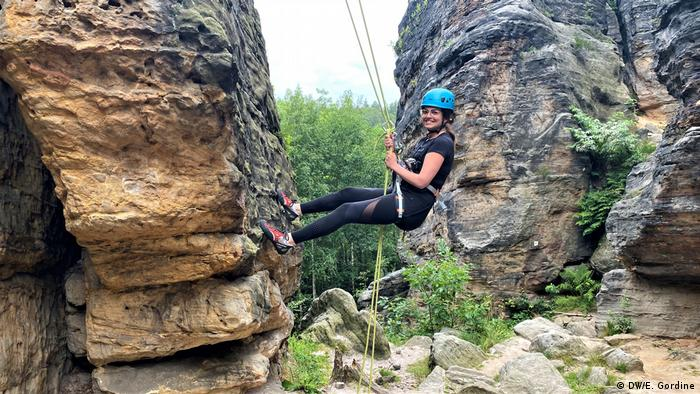 Reporter Olivera Zivkovic rock climbing in the Saxon Switzerland region of eastern Germany