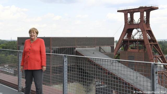 German Chancellor Angela Merkel visits a former coal mine