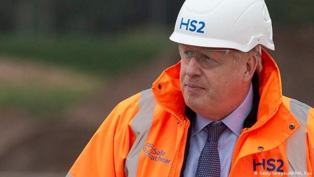 Britain's Prime Minister Boris Johnson in an orange high-vis jacket and hard hat
