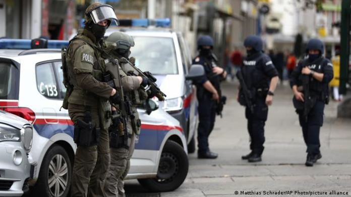 Police officers guard the scene in Vienna, Austria, Tuesday, Nov. 3.