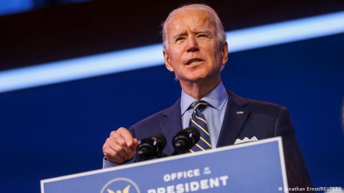 US President-elect Joe Biden delivers a speech at his transition headquarters in Wilmington, Delaware