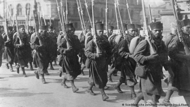 troops marching and holding guns