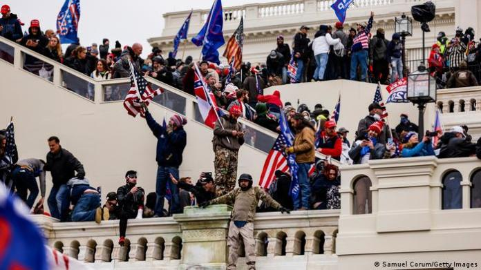 Protesters storm the stairs of the US Capitol