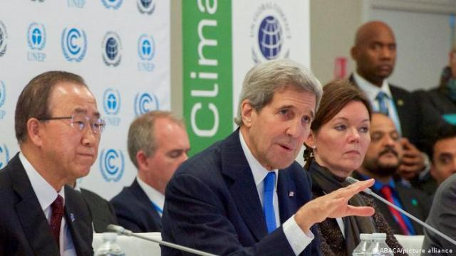 US former Secretary of State John Kerry signing the Paris Agreement