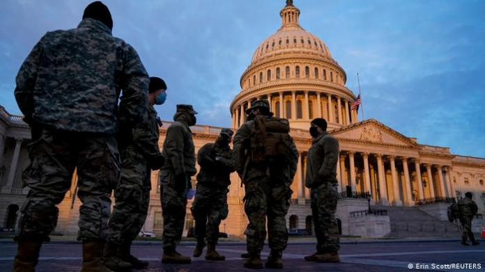 Members of the National Guard arrive at the U.S. Capitol at sunrise days after supporters of US President Donald Trump stormed the Capitol in Washington.