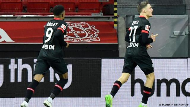 Bayer Leverkusen's Leon Bailey and Florian Wirtz celebrate the winning goal against Dortmund together