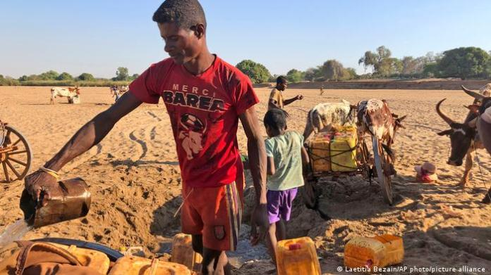 Men dig for water in the dry Mandrare river bed, in Madagascar
