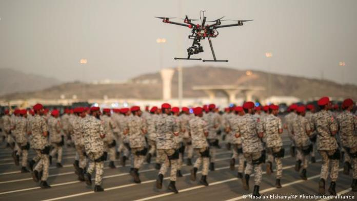A drone is used to record a military parade by Saudi security forces.
