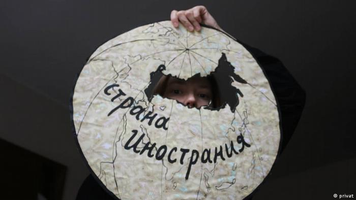 Artwork by Daria Apakhonchich, 'Land of Strangers', showing a whole in the shape of Russia on a white globe