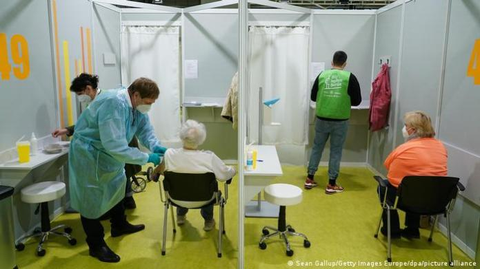 Older people are vaccinated against COVID-19 at a vaccination center in Berlin