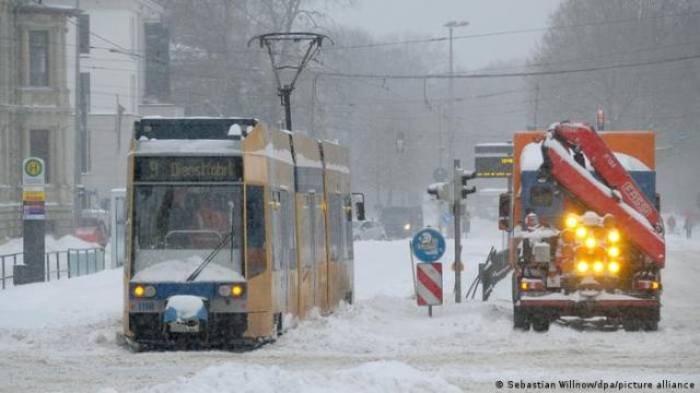 A tram and a snow plow in Leipzig