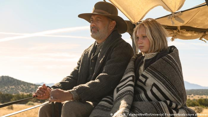 Helena Zengel and Tom Hanks on a prarie in the USA in a still from 'News of the World.'