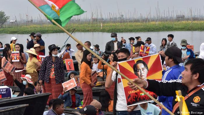 Myanmar coup protesters in boats