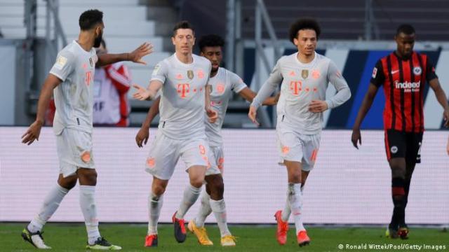 Bayern Munich players celebrate Robert Lewandowski's early second half strike in Frankfurt