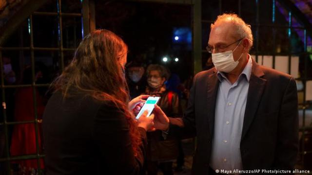 A man presents his Green pass at a theatre in Jerusalem