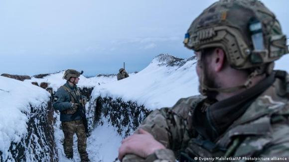 Ukrainian troops guard their position on the frontline near Vodiane