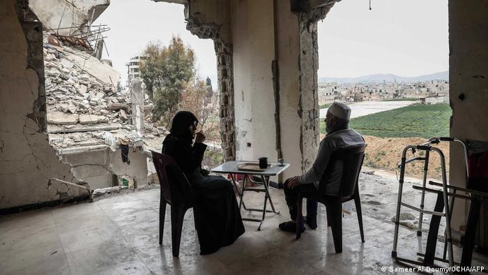 Sameer Al-Doumy captures a woman and husband drinking coffee at home in Douma