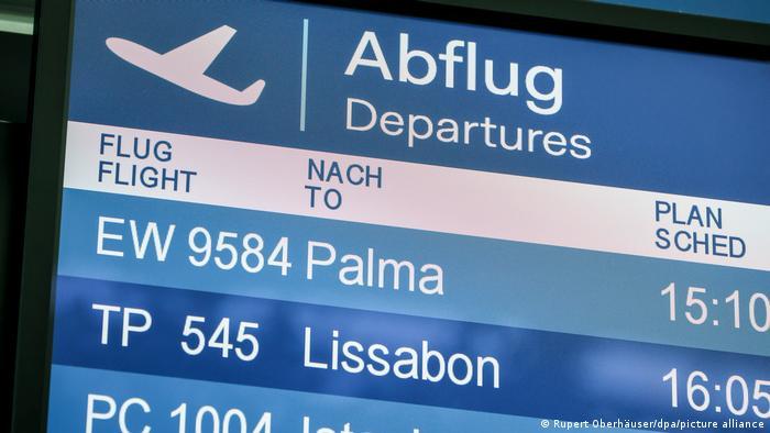Flight departures display at Düsseldorf Airport in Germany