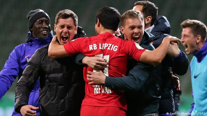 Julian Nagelsmann celebrates RB Leipzig's victory over Werder Bremen with goalscorer Hee-Chan Hwang