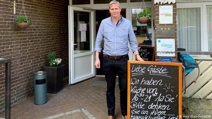 Hotelier Marco Lass of the Strand Hotel in North Frisia outside his business