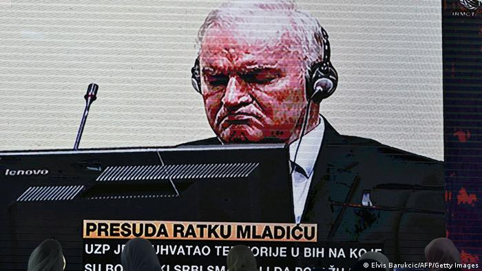 Former Bosnian Serb military chief Ratko Mladic appears on the screen of a live television broadcast from The Hagu