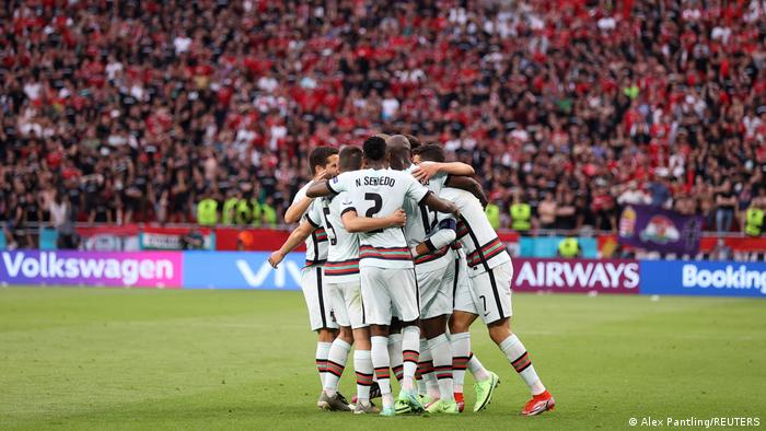 Portugal players celebrate a goal against Hungary
