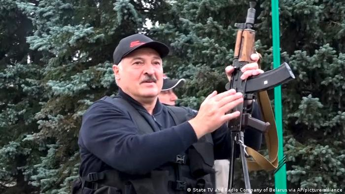 Belarusian leader Alexander Lukashenko holding a Kalashnikov-type rifle in a video still released by state television