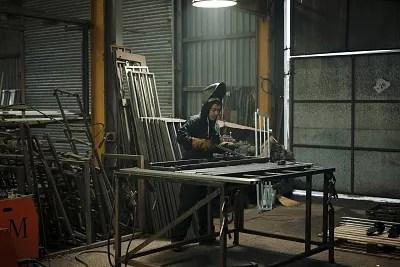Mohammad Karkoubi makes rails for a trailer.