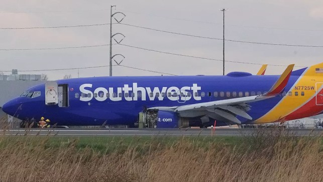 One dead as US passenger plane engine blast forces emergency landing