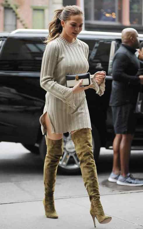 Chrissy Teigen wearing thigh-high boots