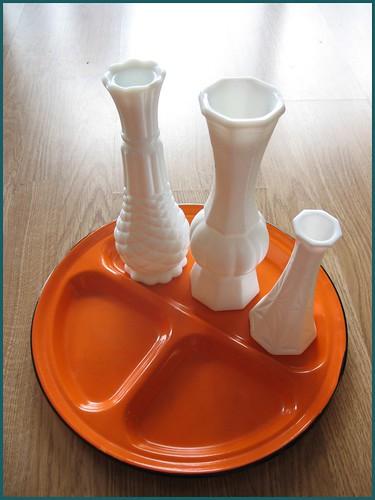milk glass vases and orange metal tray