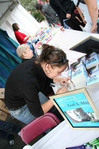 Lori A. May Signs My Book