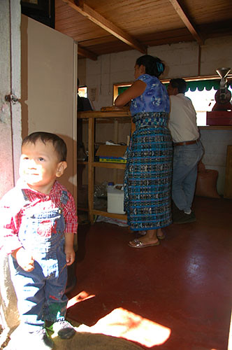 Lago Atitlan San Pedro - 06 Kid in San Pedro Coffee shop