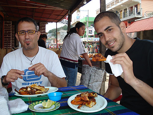 San Juan Chamula - 03 Enjoying some chicken