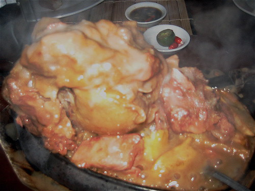 Sizzling hot pochero steak