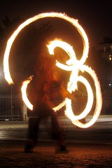 A street performer twirls fire for our amusement and money.