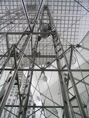 Image of the glass elevator riding its futuristic steel frame from the observation deck of La Grande Arche